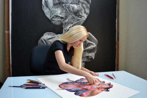 Artist at work on paper