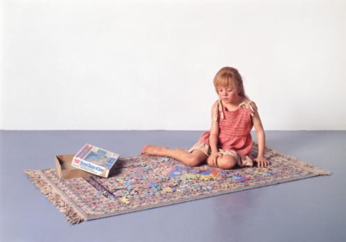 Child with Puzzle by Duane Hanson, 1978. Polyvinyl, polychromed in oil, mixed media with accesories