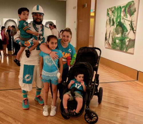 Dolphins family fan