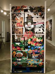 Friends in Freshness, 2017 by Narsiso Martinez. Ink, gouache, charcoal and collage on produce cardboard boxes. 78 x 40 x 48 in