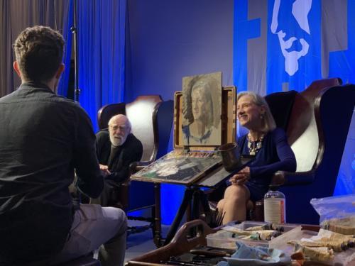 Joshua LaRock paints prtrait of Wende Caporale while Gabriela Gonzalez Dellosso paints Daniel E.Greene