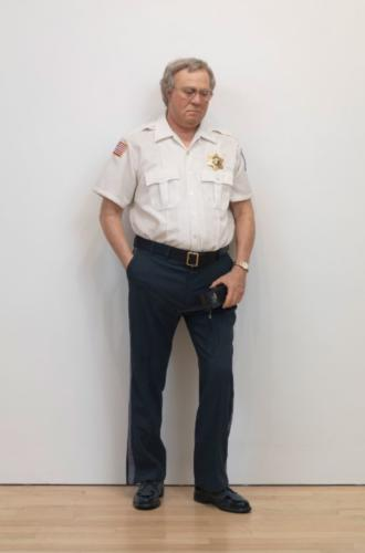 Security Guard by Duane Hanson, 1990. Autobody filler polychromed in iol, mixed media, and accessories, 71x26x13
