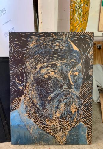 Self Portrait, acrylic on carved wood