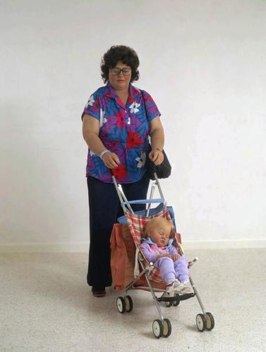 Woman with Child in a Stroller by Duane Hanson, 1985. Autobody filler, polyvinyl and mixed media with accessories. Life Size.